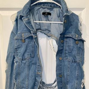 MISSGUIDED distressed blue jean jacket.